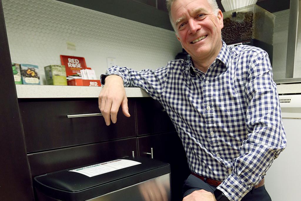 Dennis Cunningham displaying ACU's compost system
